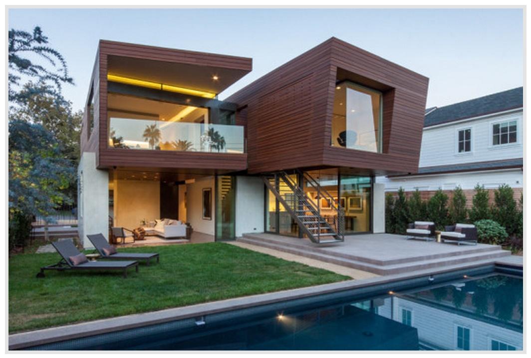Contrafachada de casa de madera moderna for Casas de madera modernas