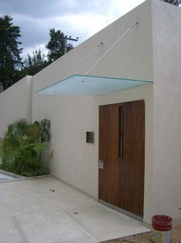 Fachadas de casas con marquesinas for Fachadas de casas modernas con zaguan