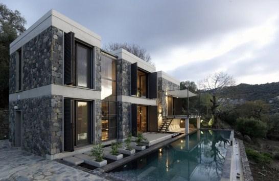 Fachadas de casas modernas con muros de piedra
