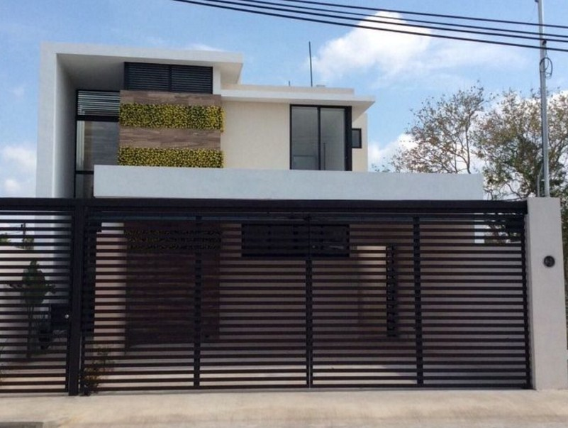 Fachadas de casas con balcon y cochera con rejas