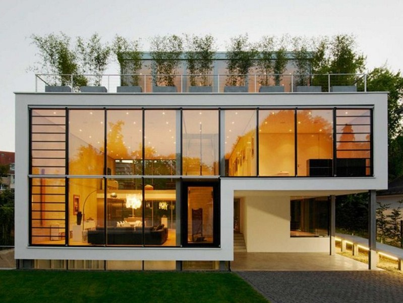 Facades of minimalist houses with glass