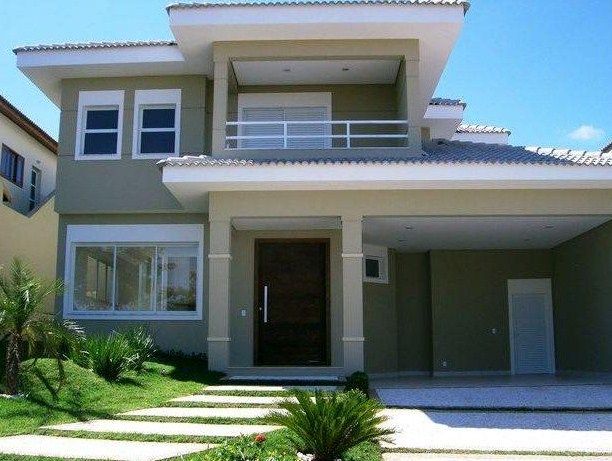 fachadas de casas con balcon y cochera
