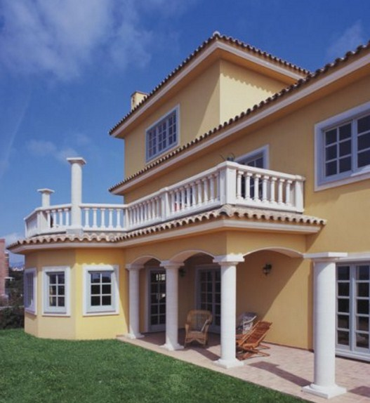 Facades of houses with white columns