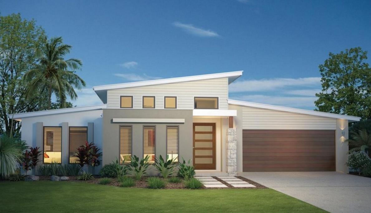 Fachada de casa amplia, con jardín frontal y garaje doble