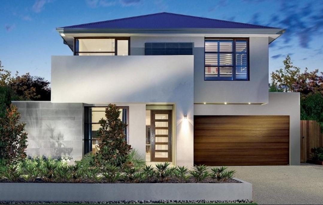 Fachada de casa moderna con cantero frontal