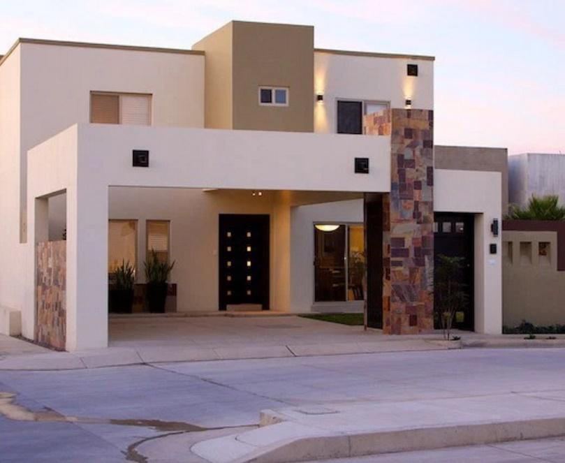 fachada de casa moderna con revestimientos en laja