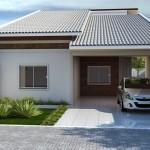 Fachada de la casa pequeña con garaje abierto