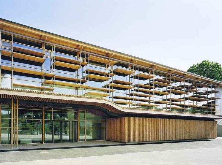 Facades with vertical and horizontal sunshades