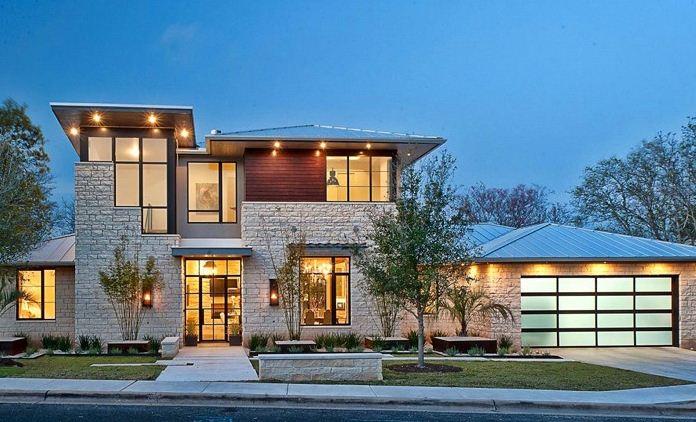 diseño de fachadas de casas de 2 pisos con piedras