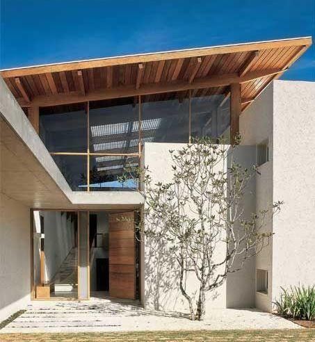 fotos de casas simples de dos pisos