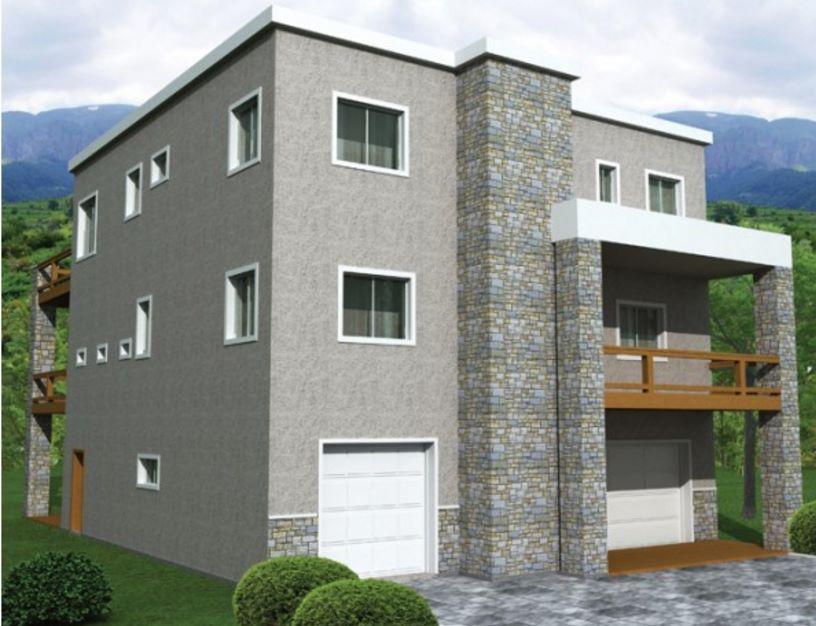 Casa de tres pisos con revestimiento en piedra