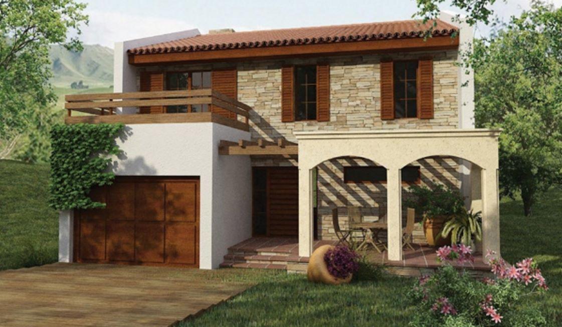 Fachada de una casa revestida en piedra y madera casas y - Piedra fachada exterior ...