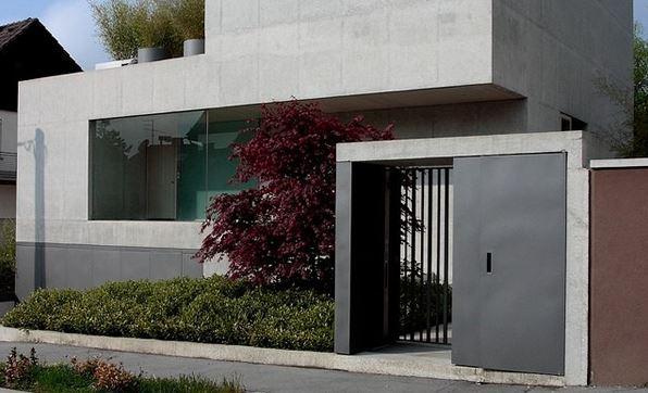 Fachadas de casas con rejas y portones for Puertas para casas minimalistas