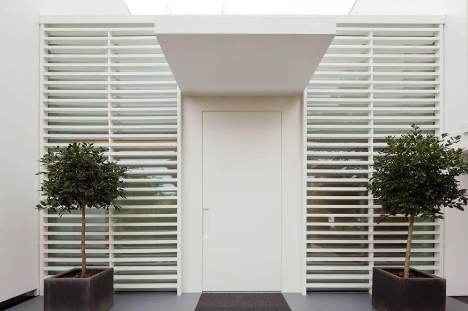 Rejas horizontales minimalistas for Frentes de casas minimalistas
