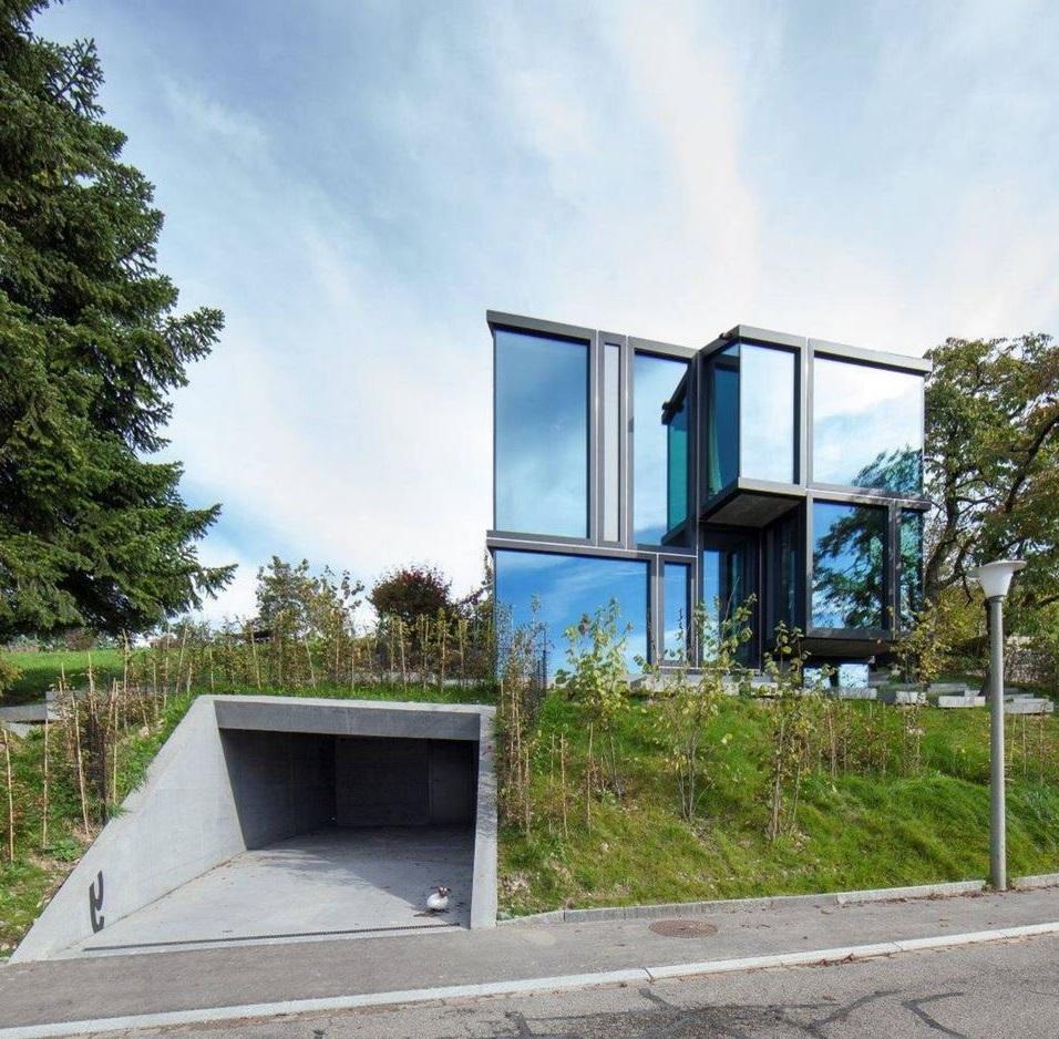 Fachadas de casas con garaje en subsuelo for Casas minimalistas modernas con cochera subterranea