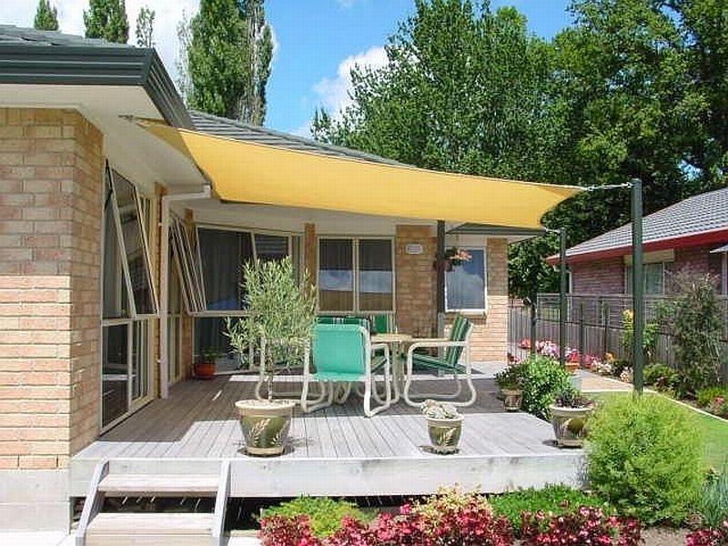 Contrafachadas de casas for Toldos extensibles baratos