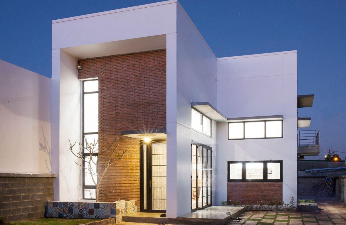 20 fachadas de casas modernas de dos pisos con techo plano for Ventanas para techos planos argentina